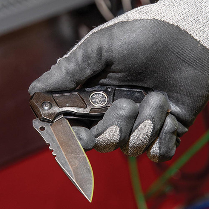 Klein Tools' Electrician's Pocket Knife is as valuable for splitting cable and stripping wire as it is for performing everyday tasks on the job site. This compact knife offers an easy one-handed, bearing-assisted opening. UPC: 092644442285   SKU: KLE44228
