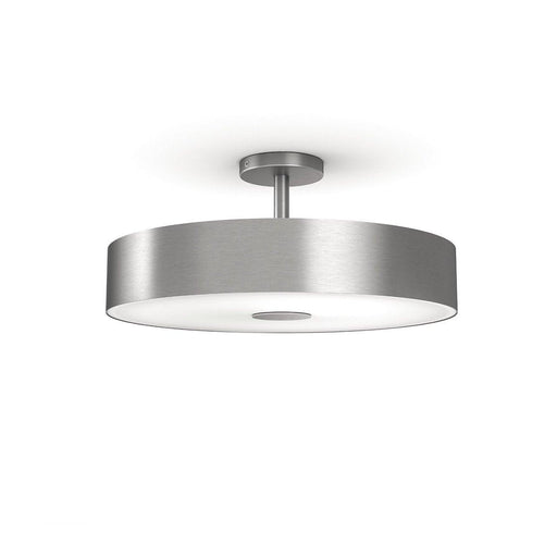 Add flair to any room with the Fair semi-suspended ceiling light, featuring thousands of shades of warm to cool white light. SKU: PHI4100148U7 UPC: 046677801366