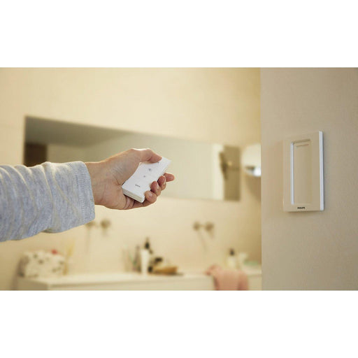 The Philips Hue Dimmer switch allows you to wirelessly turn your lights up high or down low. Both a wall switch and remote control, this smart switch attaches easily to walls with the included adhesive and can be removed from the magnetic base to use as a remote control that can be carried around. SKU: PHI473371 UPC: 046677473372