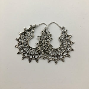 Silver ornate hoop earring