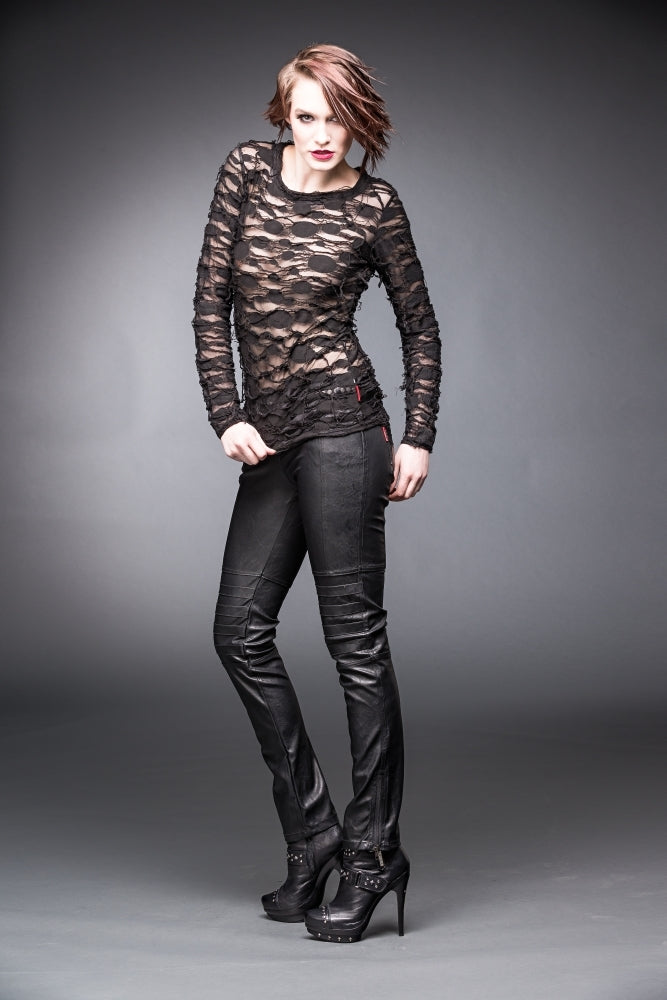 woman in Alice apocalyptic top with see through layers and black jeans Ministry of Style gothic collection