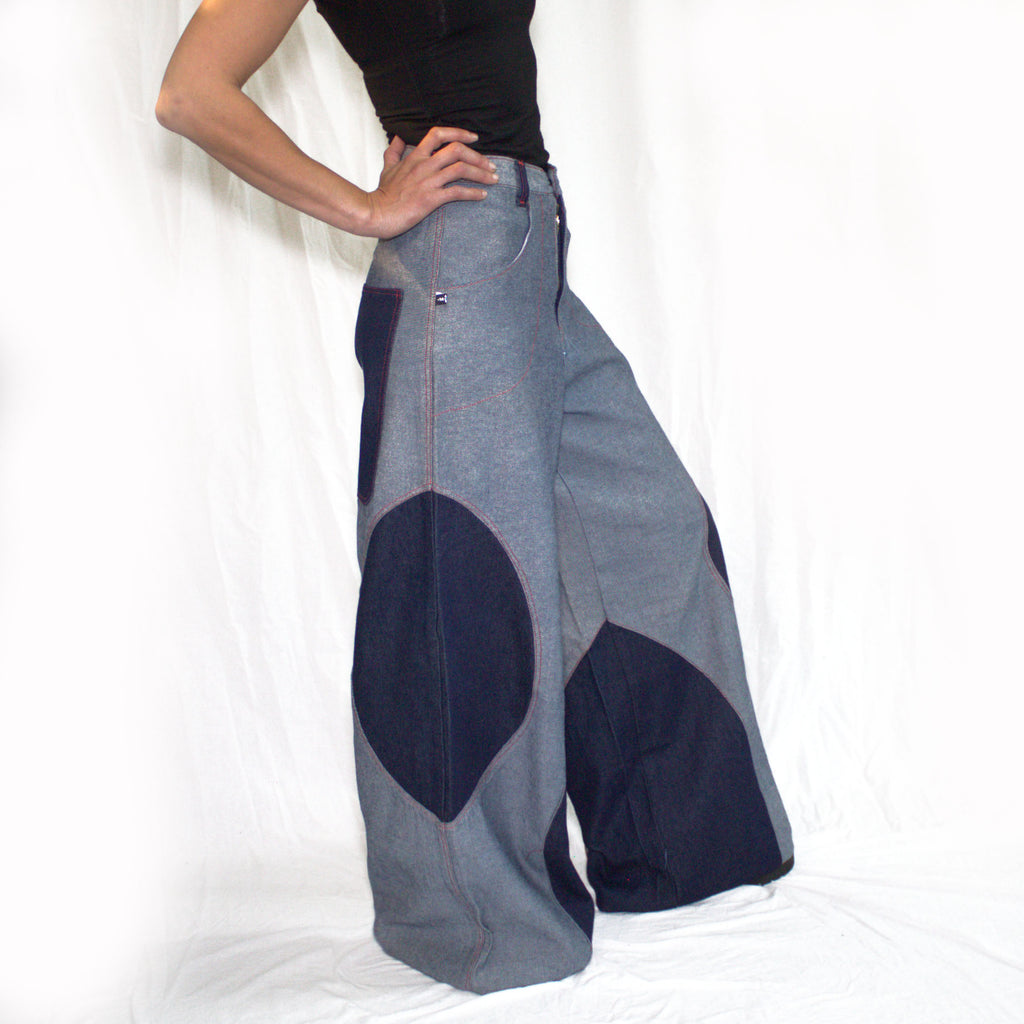Light denim circle phat pants by ministry of style side view