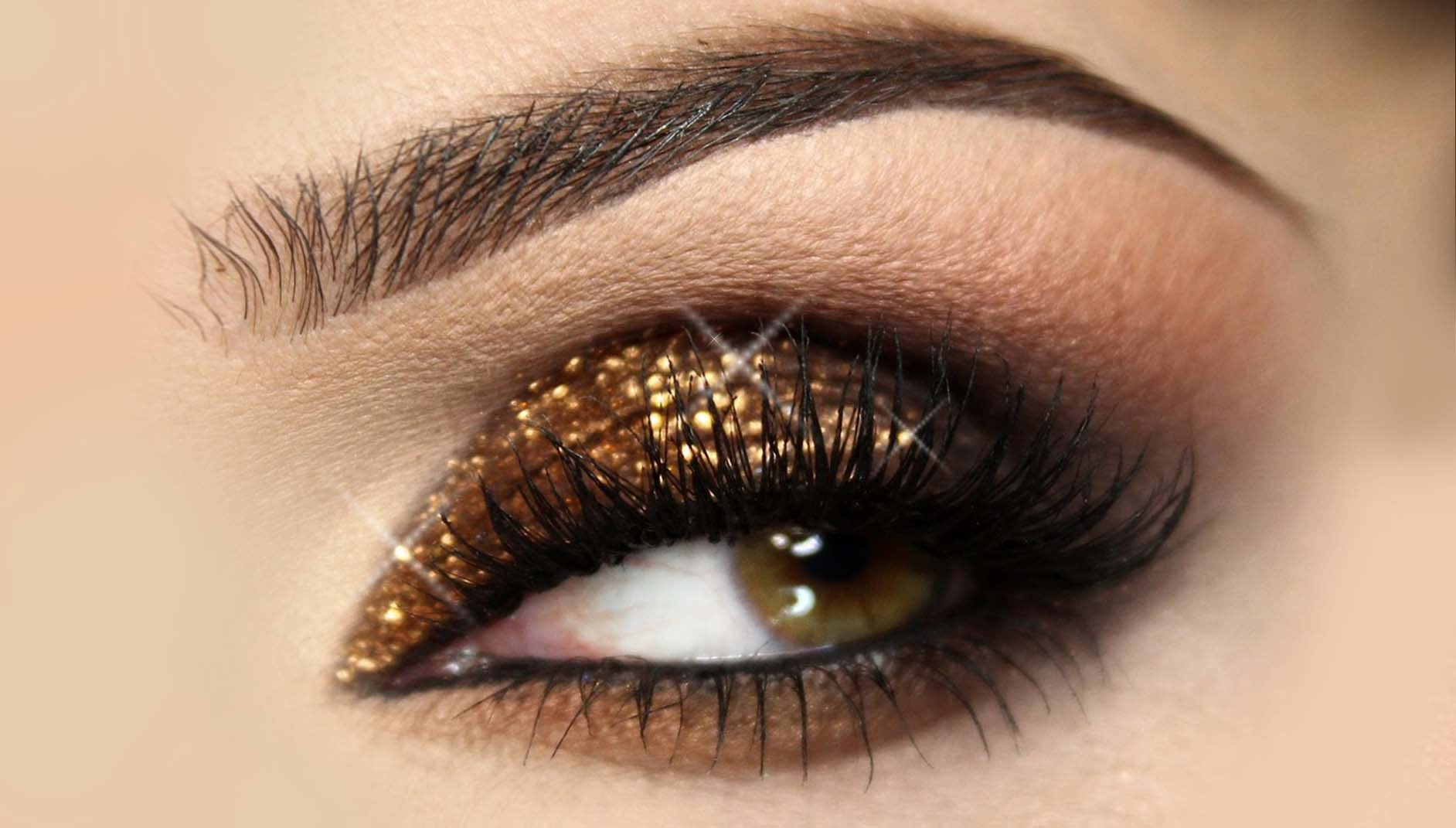 womens eye with gold glitter eyeliner on