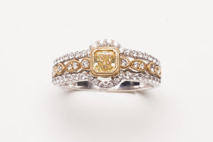 Lady's Two-Tone Fashion Ring With 54=0.38Tw Round Diamonds And One 0.33Ct Princess Cut Yellow Diamond