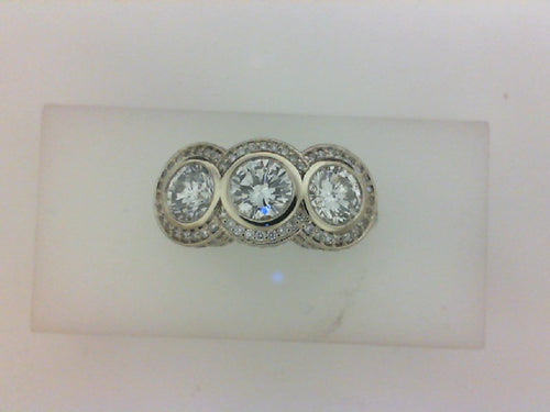 1.62CTTW 3 STONE RING WITH 158 RD DIA .49CTTW