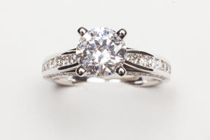 14K WG .44CTTW DIAMOND CHANNEL MTG CZ CENTER