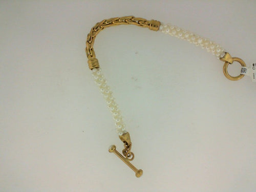 YG LINK IN CENTER OF PEARL BRAC W TOGGEL CLASP