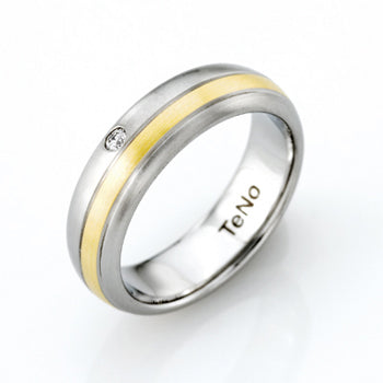 TAMOR 6MM W .04CT DIA 18KT 1 2ROUND RING