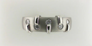 PLAT .25CT TW DIAMOND BAND SZ 9 & UP quantum leap