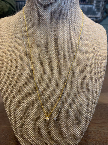 Tiny cross necklace gold