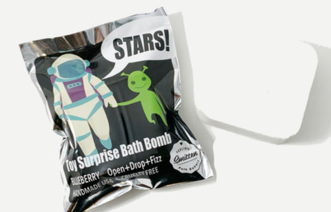 Astronaut toy surprise bath bomb