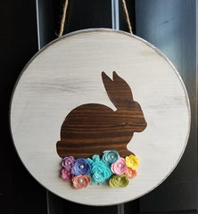 round wooden bunny sign