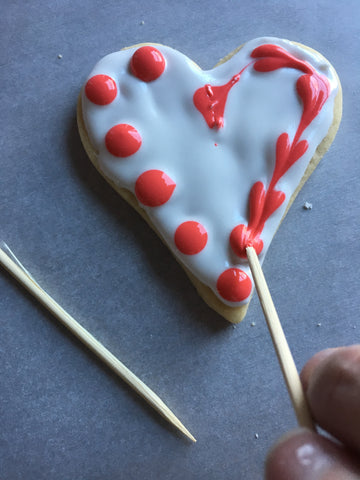 decorating heart sugar cookies with royal icing