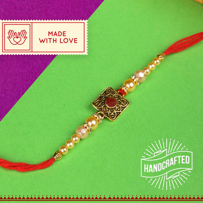 Red Gem in Golen Antique Motif Rakhi with  Roli Chawal & Kalawa For Men