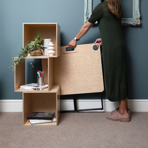 Dezeen Showroom: workspace furniture brand Spacestor has created a compact, foldable and portable desk called KIT, in a bid to help users work more comfortably from their own home.