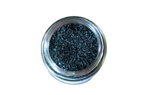 Activated charcoal in a glass jar