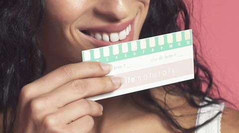 a woman using Dr. Brite product for teeth whitening
