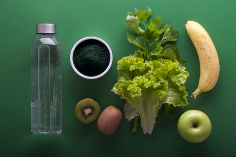 a bottle of water, fruits and vegetables