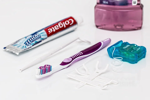 a toothpaste, toothbrush, dental floss and mouthwash