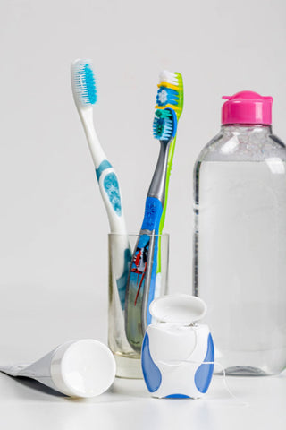 toothbrushes, toothpaste, dental floss and mouthwash