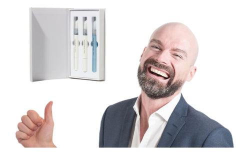a smiling man pointing at Dr. Brite's set for teeth whitening