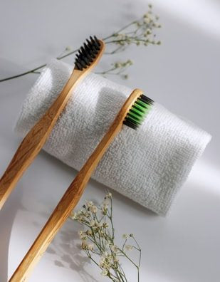 two wooden brushes and a white towel