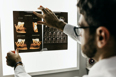 A dentist looking at the x-ray