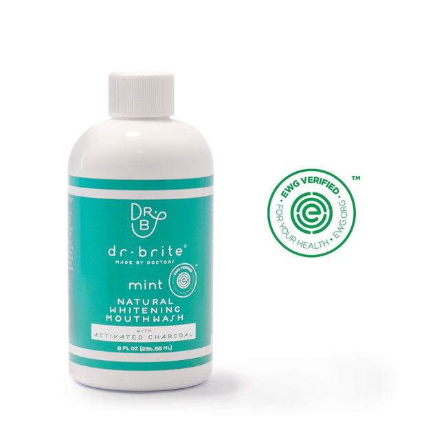 A bottle of EWG verified, Effective, Alcohol-Free, Fluoride-Free, Natural Mint Mouthwash with Activated Charcoal and Coconut Oil.