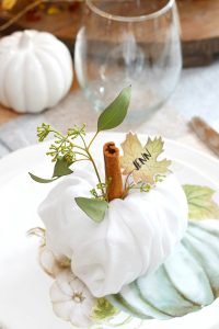 Create pretty Thanksgiving place settings with these cute napkin fold pumpkins and free printable leaf name tags