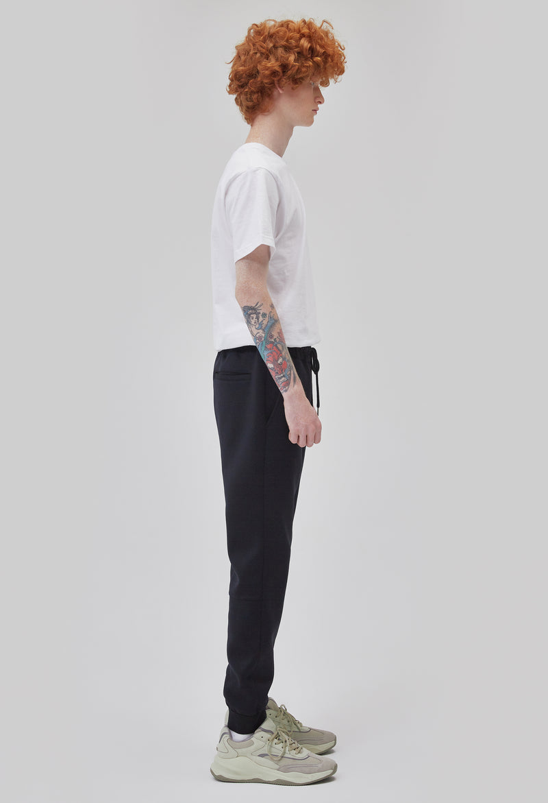 ZENSAI Double Logo Slim Black Jogger with Embroidered Details Side View on Male Model