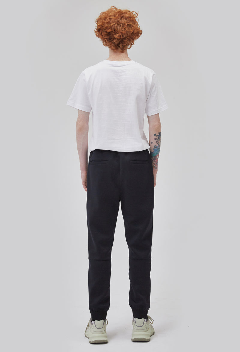 ZENSAI Double Logo Slim Black Jogger with Embroidered Details Back View on Male Model