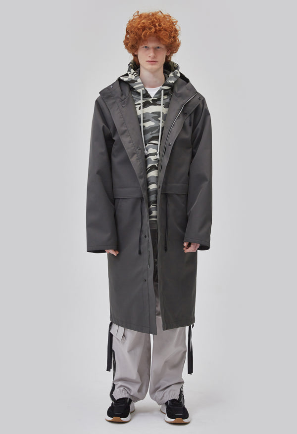 ZENSAI Graphite Grey Long Hooded Parka with Dangling Straps Front View on Male Model