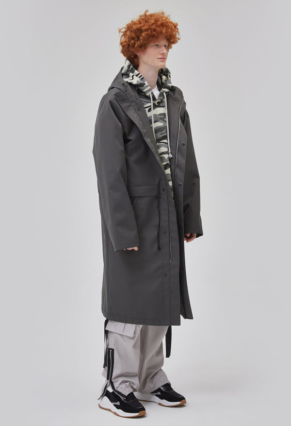 ZENSAI Graphite Grey Long Hooded Parka with Dangling Straps 3/4 Side View on Male Model