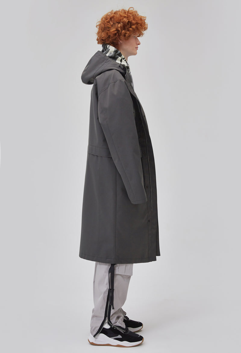 ZENSAI Graphite Grey Long Hooded Parka with Dangling Straps Side View on Male Model