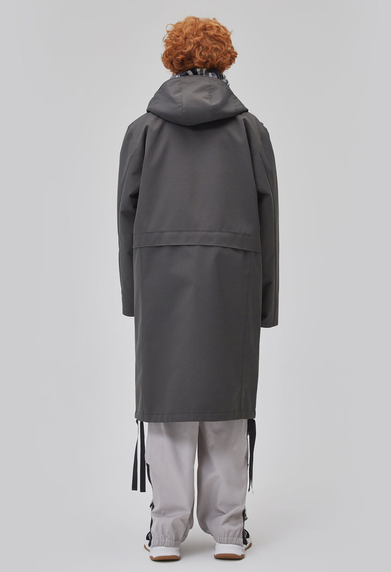 ZENSAI Graphite Grey Long Hooded Parka with Dangling Straps 3/4 Back View on Male Model