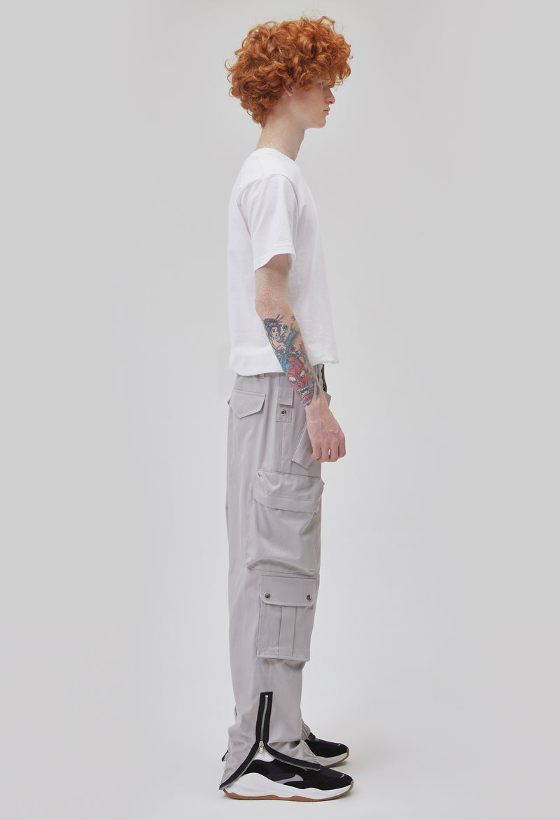 ZENSAI Loose Light Grey Cargo Ankle Zip Pant with Multiple Pockets and Ankle Zippers Side View on Male Model