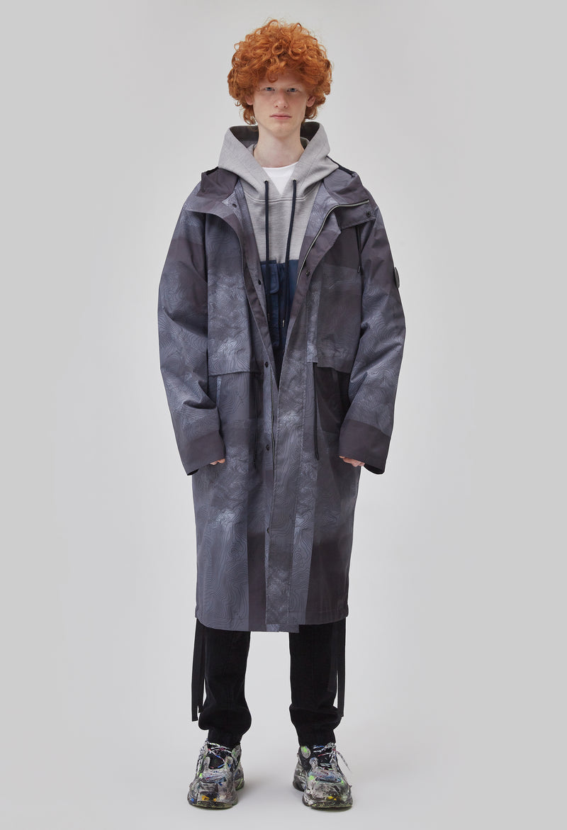 ZENSAI Tech Grey Breeze Long Parka with Dangling Straps Front View on Male Model