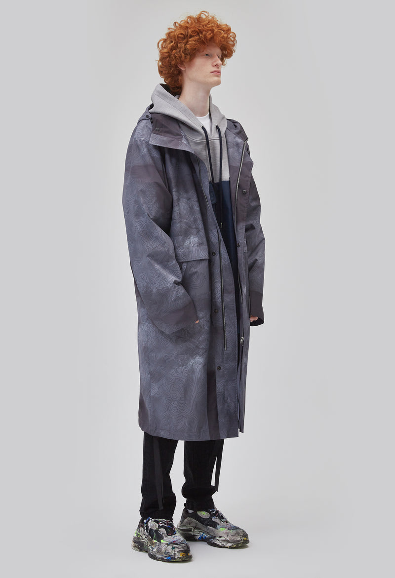 ZENSAI Tech Grey Breeze Long Parka with Dangling Straps 3/4 Front View on Male Model