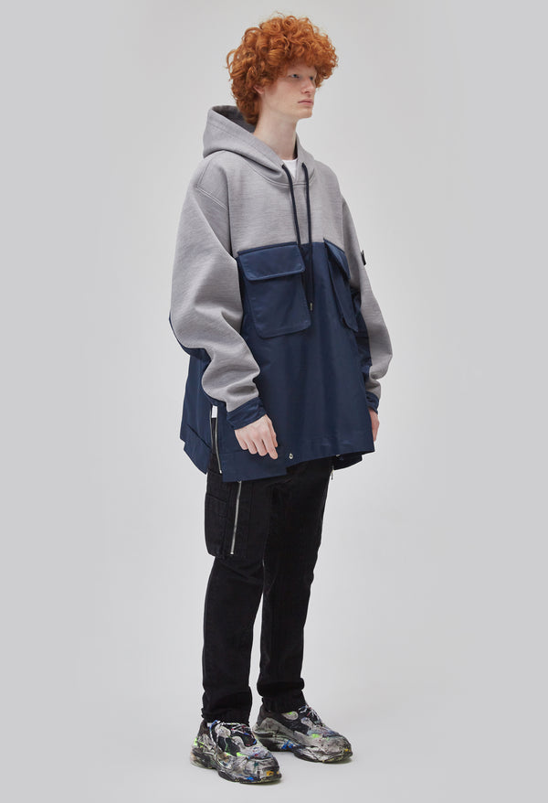 ZENSAI Two-Tone Grey and Blue Side Split Oversized Pullover Hoodie with Arm Logo Detail 3/4 Front View on Male Model
