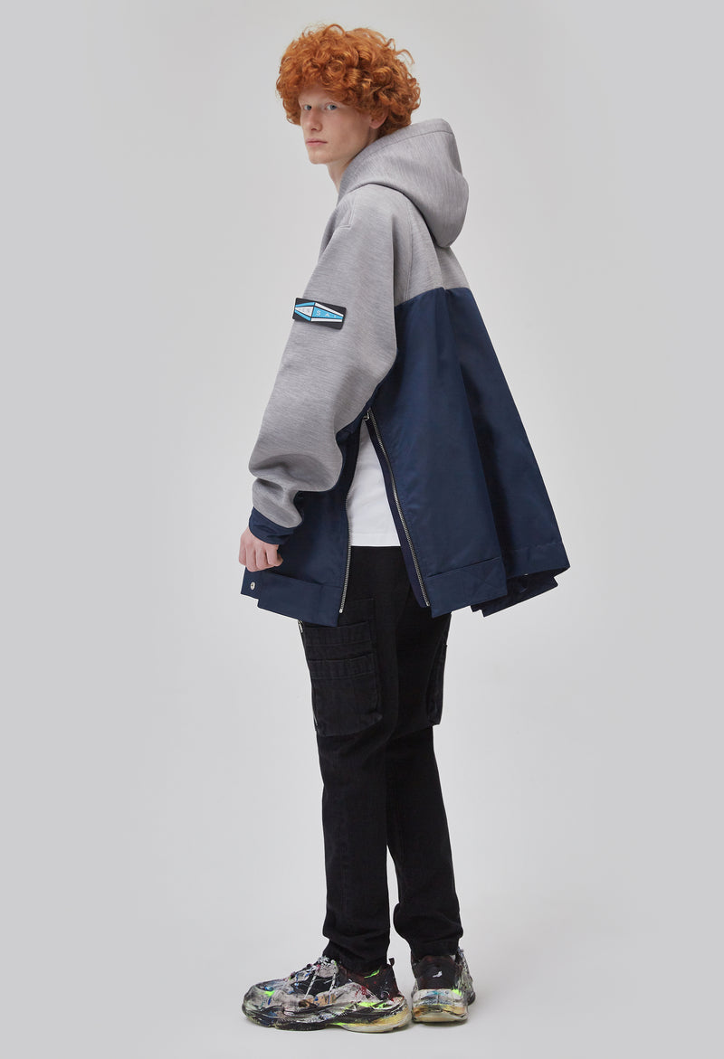 ZENSAI Two-Tone Grey and Blue Side Split Oversized Pullover Hoodie with Arm Logo Detail Side Splits Open Dynamic Side View on Male Model