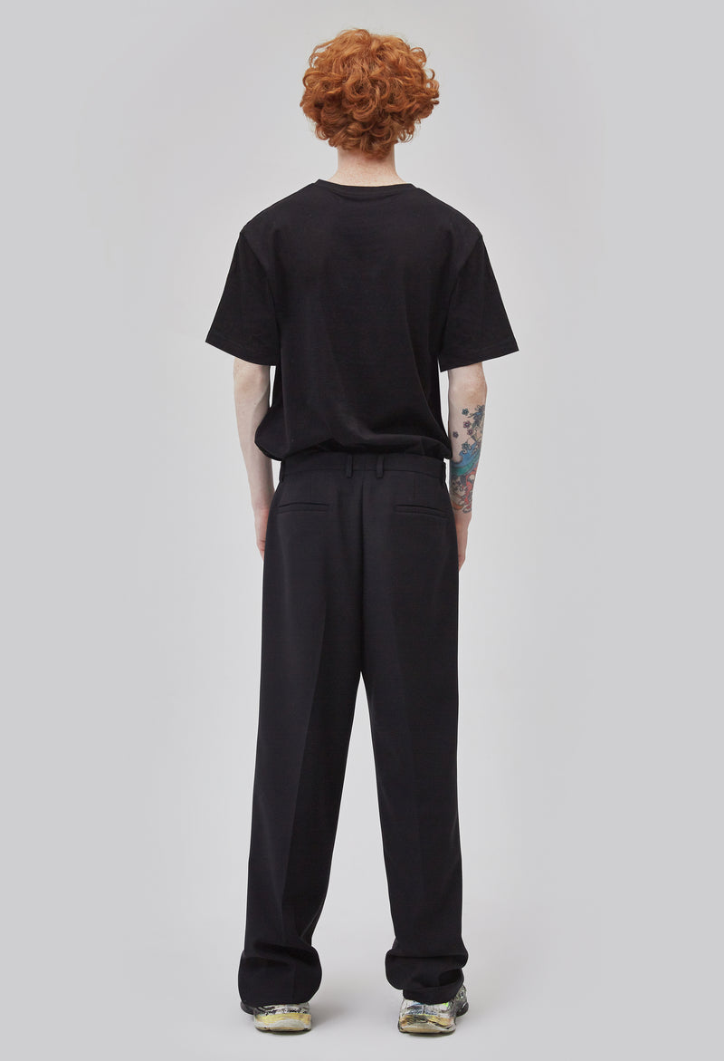 ZENSAI Black Relaxed Trousers Back View on Male Model