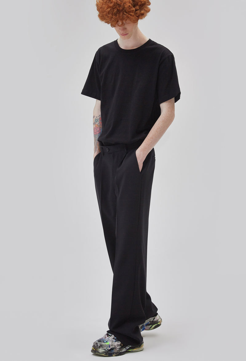 ZENSAI Black Relaxed Trousers 3/4 Front View on Male Model