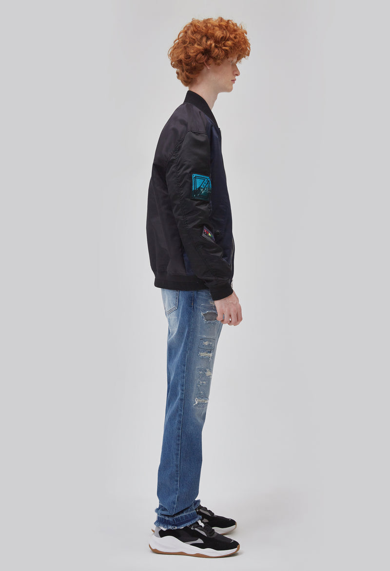 ZENSAI Black and Blue Patched Bomber Jacket Side View on Male Model