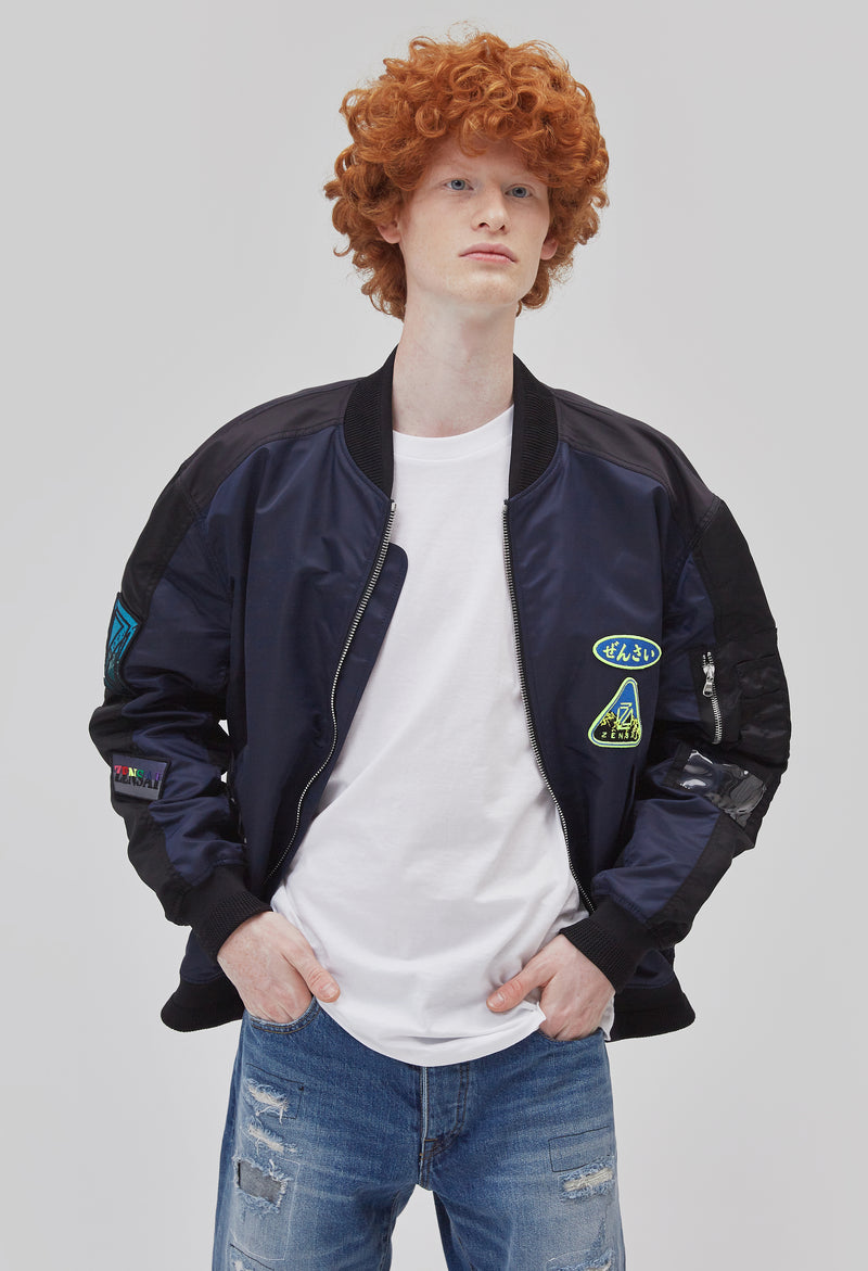 ZENSAI Black and Blue Patched Bomber Jacket Unzipped Front View on Male Model