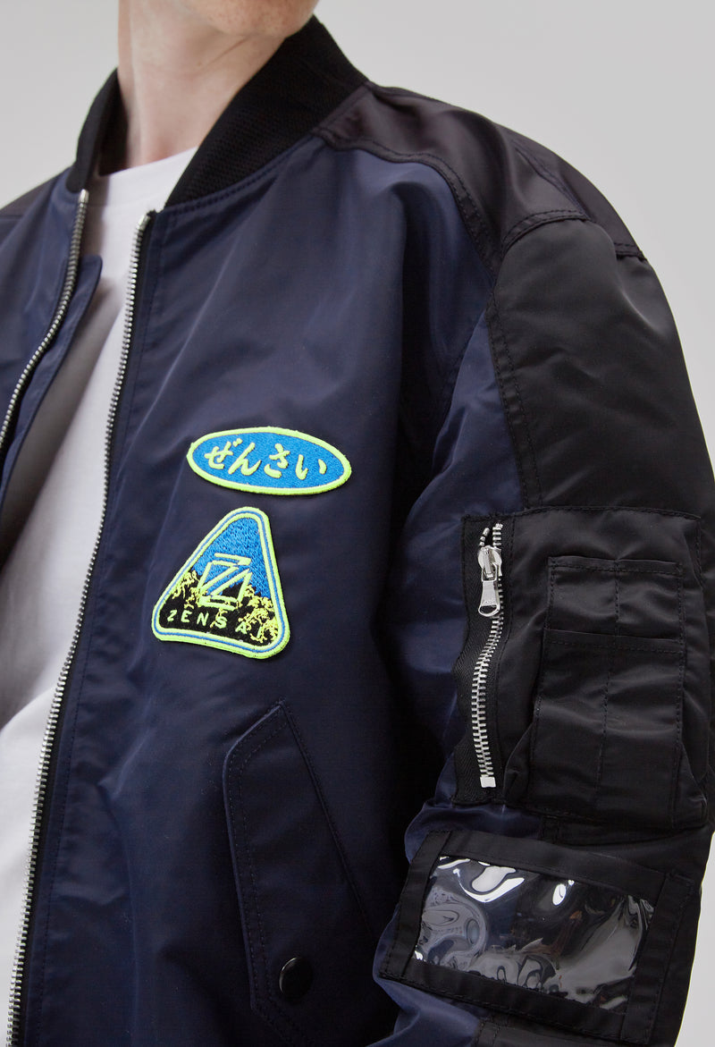 ZENSAI Black and Blue Patched Bomber Jacket Patch Logo Details on Male Model