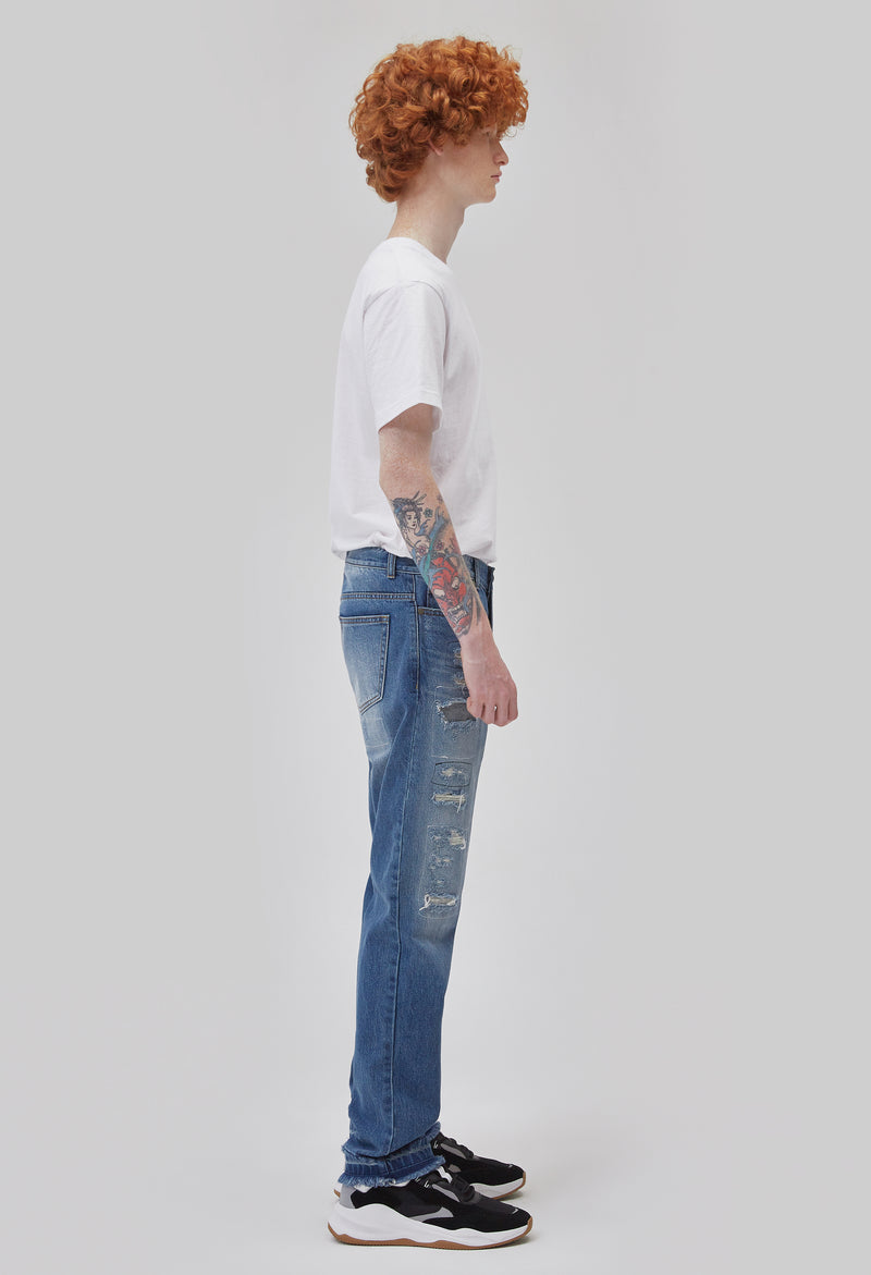 ZENSAI Distressed Patched Blue Jeans Side View on Male Model