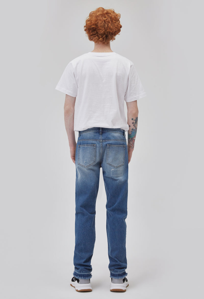 ZENSAI Distressed Patched Blue Jeans Back View on Male Model