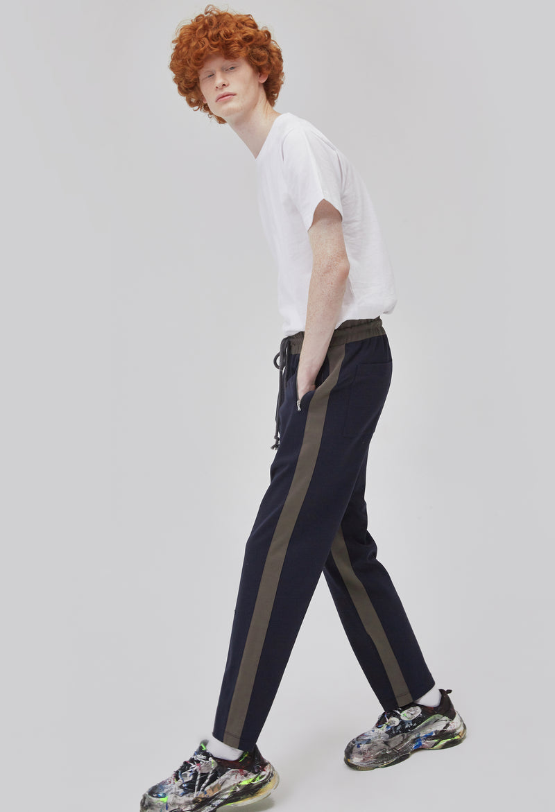 ZENSAI Dark Olive and Blue Striped Track Pants Dynamic Side View on Male Model