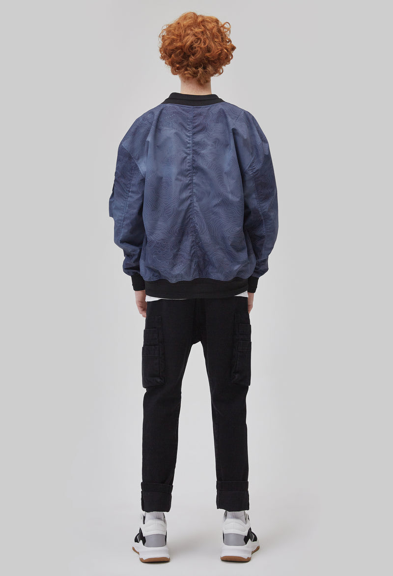 ZENSAI Space Blue Bomber Jacket with Multiple Utility Pockets Back View on Male Model