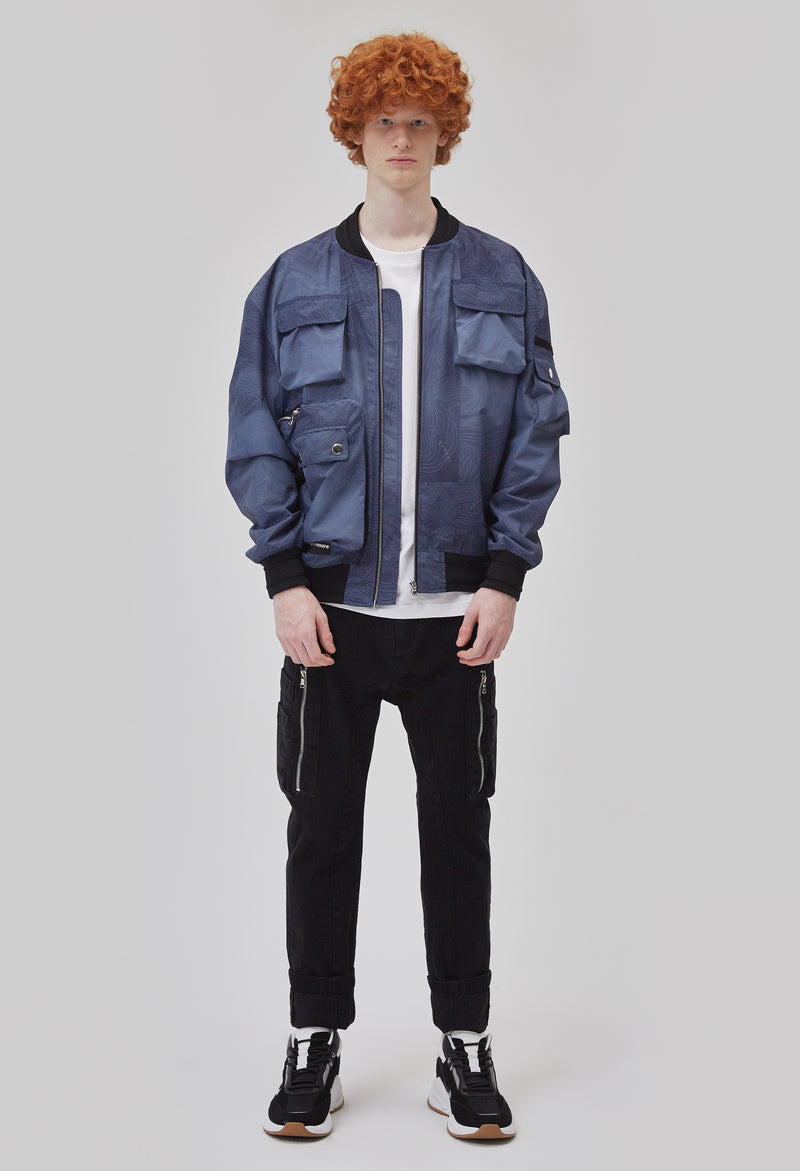 ZENSAI Space Blue Bomber Jacket with Multiple Utility Pockets Front View on Male Model